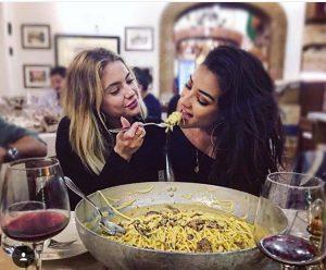 girls feeding each other pasta