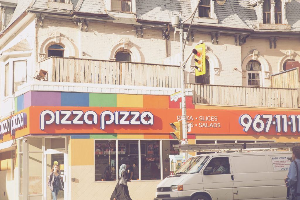pizza pizza with rainbow sign in church and Wellesley, toronto