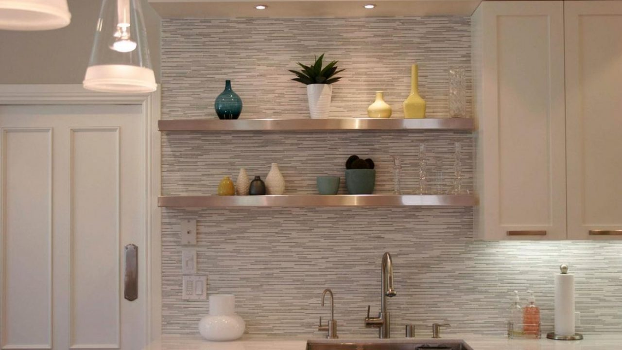 Extraordinary kitchen backsplash design with art wall decor along with led lighting under the white wooden floating cabinet also simple steel stainless shelves on the wall beside door