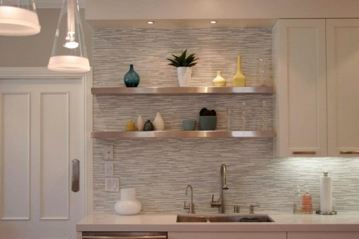 Extraordinary-kitchen-backsplash-design-with-art-wall-decor-along-with-led-lighting-under-the-white-wooden-floating-cabinet-also-simple-steel-stainless-shelves-on-the-wall-beside-door