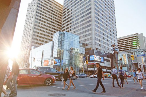 Street view of Yonge and Eglinton with people crossing