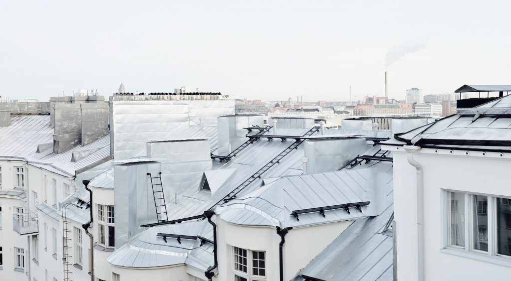 high shot showing rooftops of white apartments